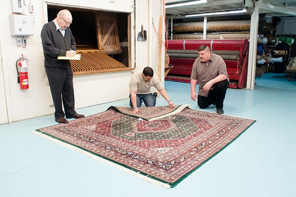 Each rug is thoroughly examined again prior to wash.