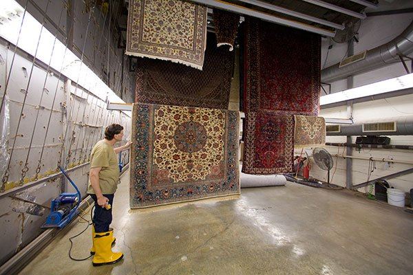 Proper drying is critical for the health of your family and the safety of your rug.  Ours is done in our engineered and enclosed dry-room.