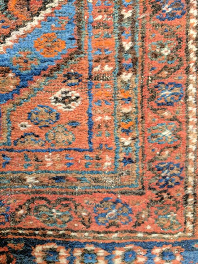 Oriental-rug-closeup-showing-wear